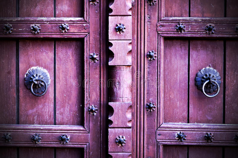 Antique wooden doors with ring door knobs stock photo
