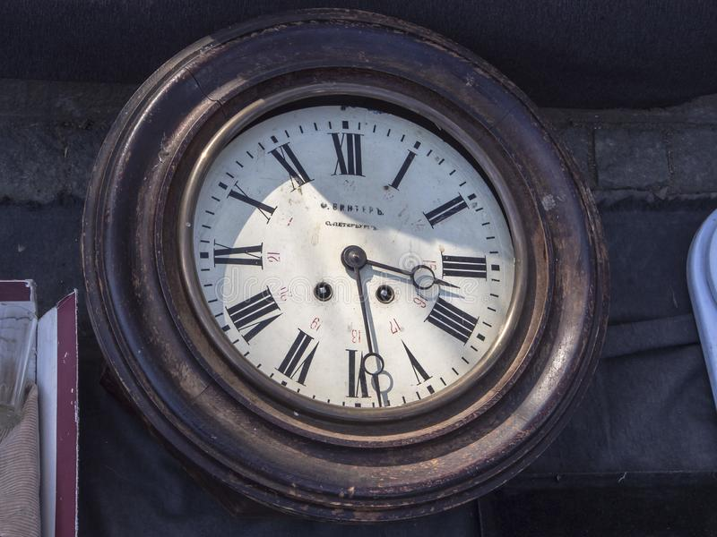 Antique wooden-framed watches are sold at the flea market stock photo