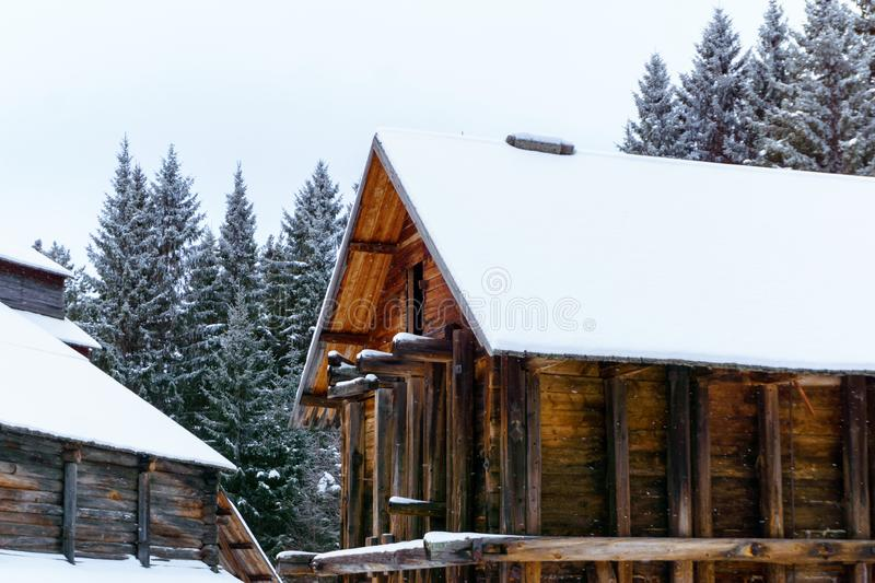 Antique wooden industrial architecture. Complex of traditional log warehouses of a salt-mining plant of the 19th century in a winter landscape stock photography