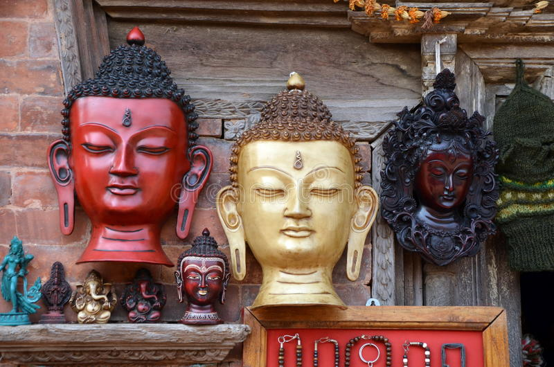 Antique wooden masks of Buddha royalty free stock images