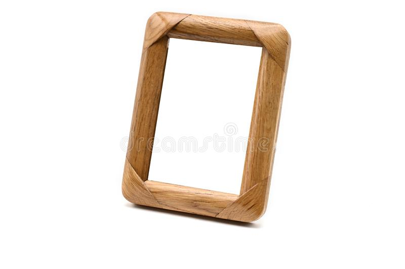 Antique wooden photo frame on an isolated white background royalty free stock photos