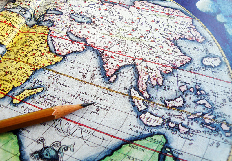 Antique world globe with pencil royalty free stock photography