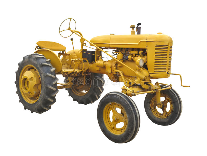 Antique yellow tractor isolated. royalty free stock images