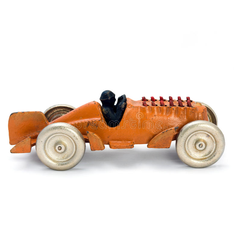 Antique yellow wind-up car. Image stock photo