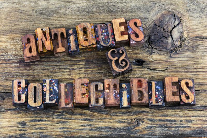 Antiques collectibles sign letterpress. Antiques and collectibles small business antique sign message letterpress type letters woodgrain background typography royalty free stock photos