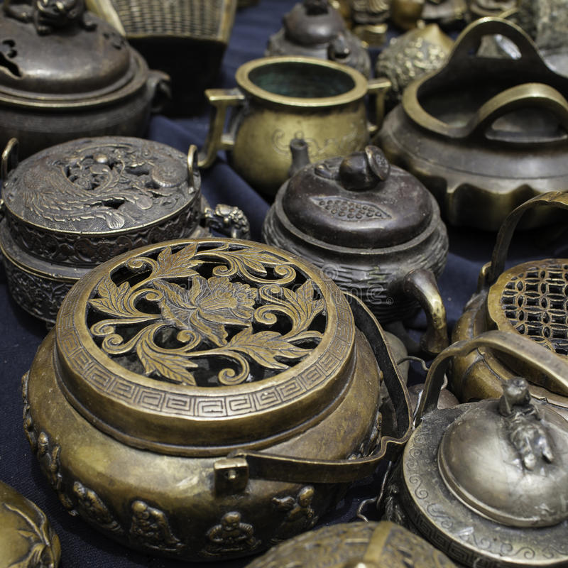 Antiques. Mostly bronze vessels for sale at a stand stock photography
