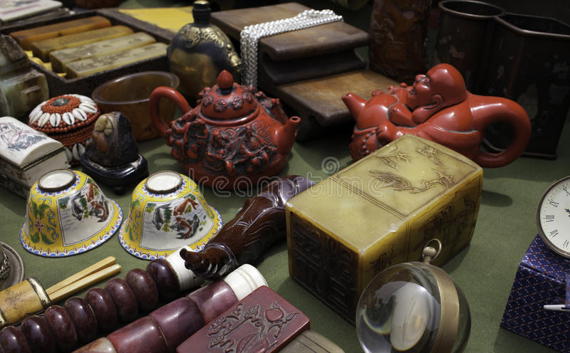 Antiques. Multifarious antiques for sale at a stand royalty free stock images
