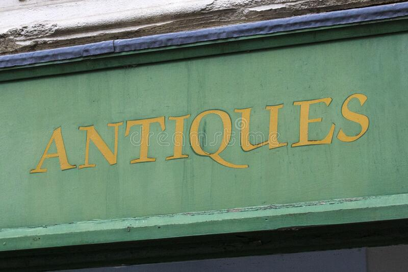 Antiques Shop. Close-up of the word Antiques on the exterior of a shop royalty free stock photo