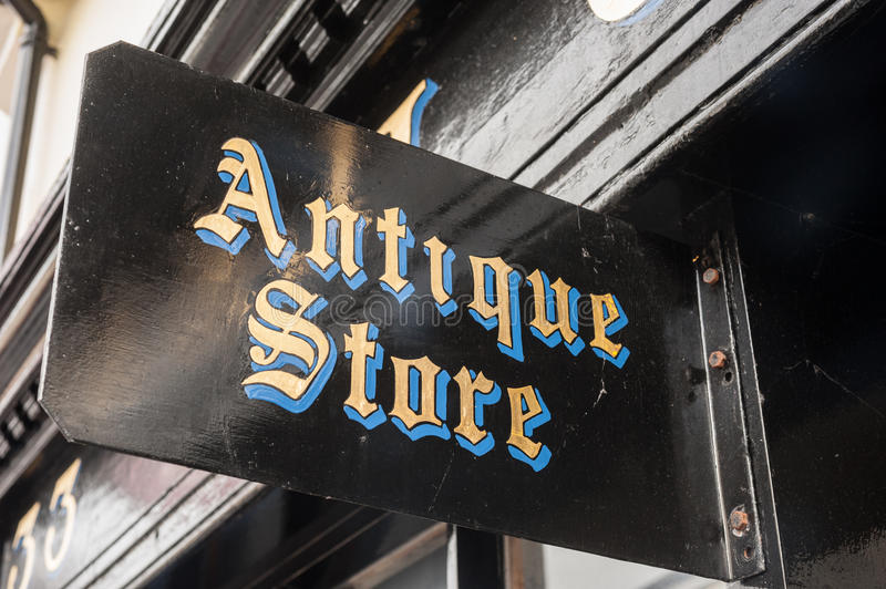 Antiques shop sign stock photography