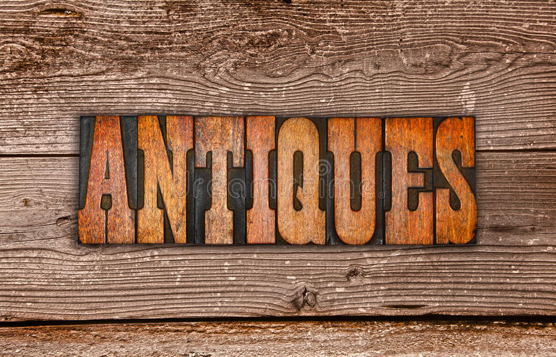 Antiques sign letterpress royalty free stock image