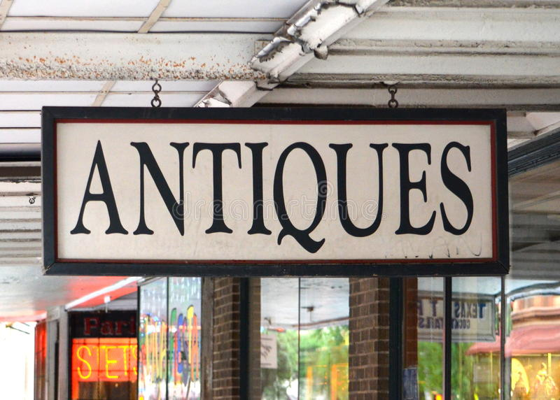 Antiques. Sign in San Antonio, TX stock photography