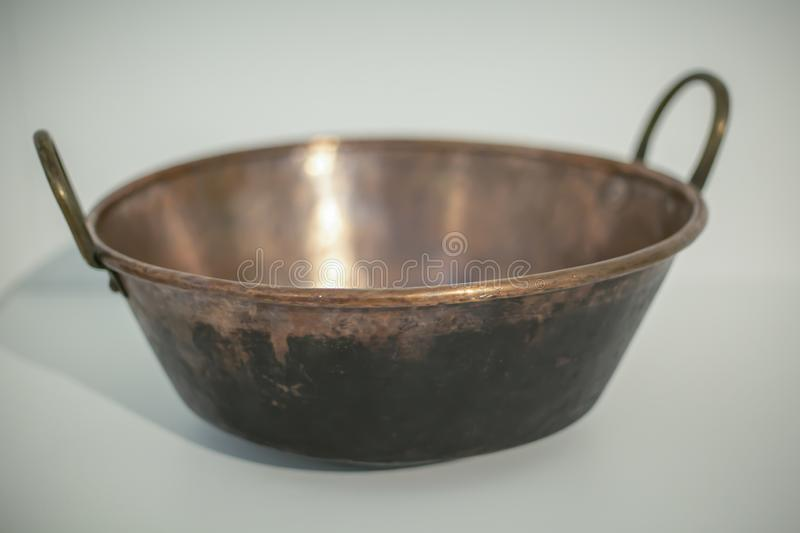 Antiques theme, Single rustic pan royalty free stock images