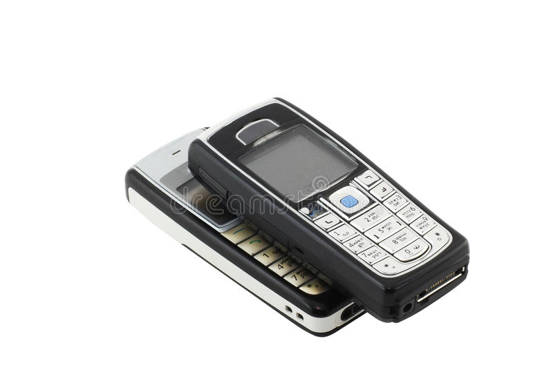 Antiques, two old cellular phones stock photos