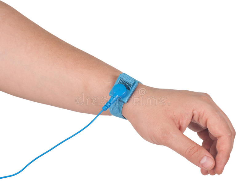 Antistatic wrist strap. Ground bracelet on man hand isolated on white background . An antistatic wrist strap, ESD wrist strap, or ground bracelet is an stock photography