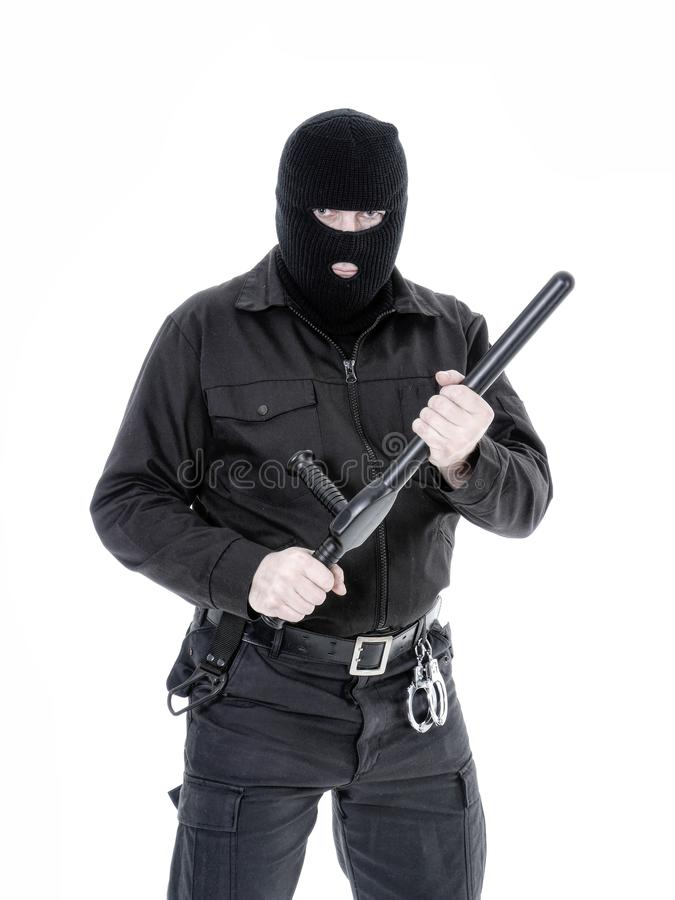 Antiterrorist policeman in black uniform and black balaclava stock image