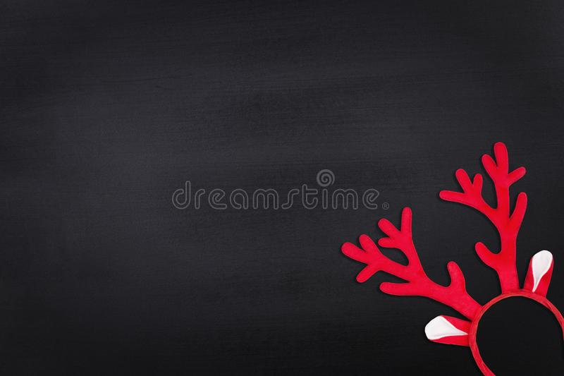 Antlers of a deer headband on chalkboard background. Flat lay royalty free stock photo