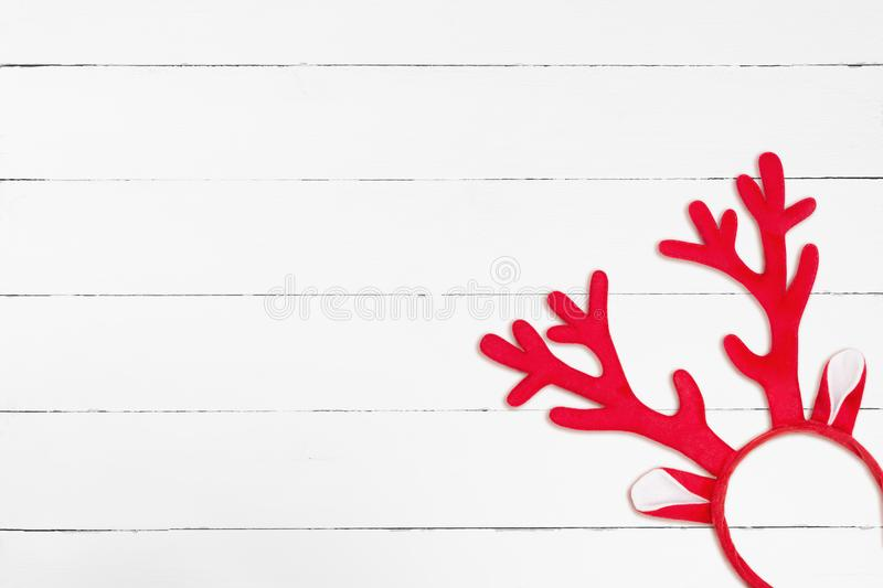Antlers of a deer headband on white wooden background stock photography
