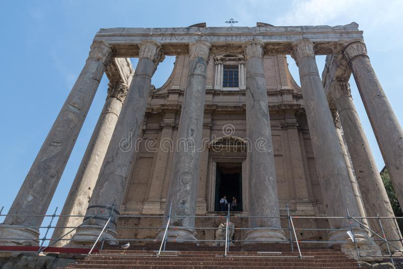 Antoninus and Faustina Temple at Roman Forum in city of Rome, Italy. ROME, ITALY - JUNE 24, 2017: Antoninus and Faustina Temple at Roman Forum in city of Rome royalty free stock photo