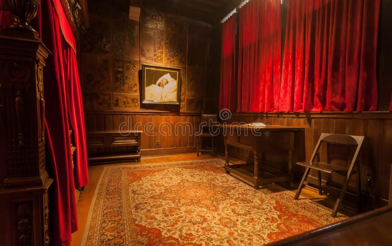 Bedroom with vintage furniture in printing museum of Plantin-Moretus, UNESCO World Heritage Site. ANTWERP, BELGIUM - MAR 30: Red bedroom with vintage furniture royalty free stock photos