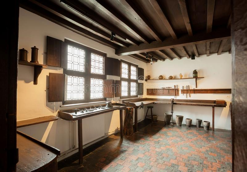Working place inside the historical house of the printing museum of Plantin-Moretus, UNESCO World Heritage Site. ANTWERP, BELGIUM - MAR 30: Working place inside stock photos