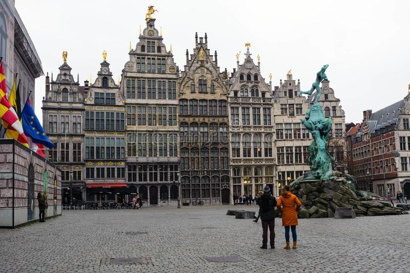 Flemish Renaissance style trading guild houses and the Brabo fountain in Markt Grotto. Antwerp on a gray autumn day royalty free stock photography