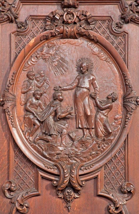Antwerp - Carved scene as st. Francis Xavier baptist the king of Maledives St. Charles Borromeo church. On September 5, 2013 in Antwerp, Belgium stock photos