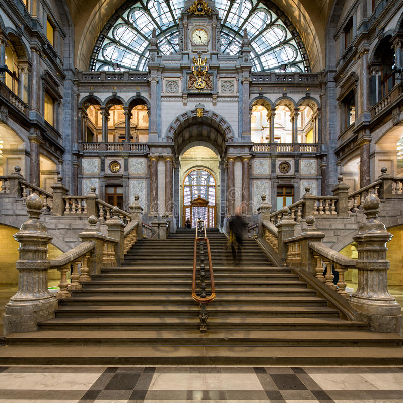 Antwerp central station. Symmetrical composition of the main hall of the famous Antwerp Railway train station, also known as the cathedral amongst stations stock image