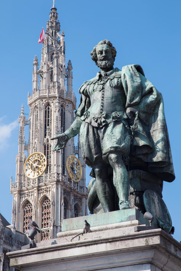 Antwerp - Statue of painter P. P. Rubens and tower of cathedral royalty free stock photography