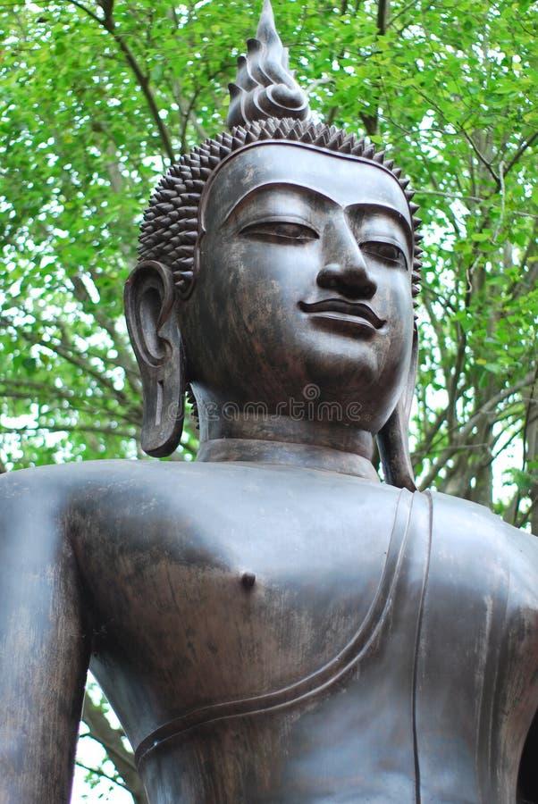 Antyczna brązowa Buddha statua tworzył wiarą w buddyzmu który istniał od antycznych czasów teraźniejszość obrazy stock