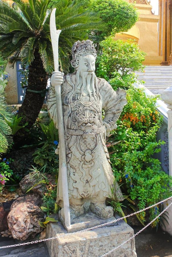 Antyczna chińska wojownik rzeźba przy Watem Phra Kaew, świątynia Szmaragdowy Buddha zdjęcie stock