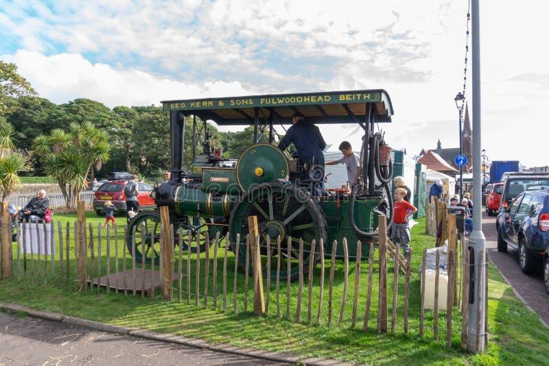Antyczna kontrpara Jadący Ayrshire ciągnik przy Largs Viking & jedzenia Fe fotografia stock