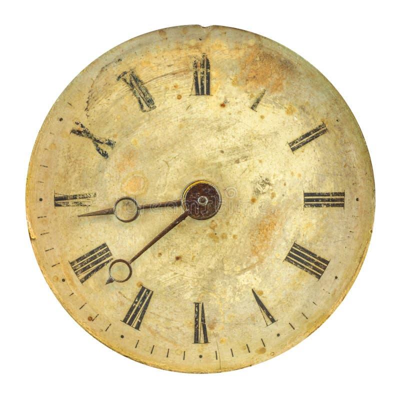 Antyczna wietrzejąca zegarowa twarz z zatartymi liczbami fotografia royalty free
