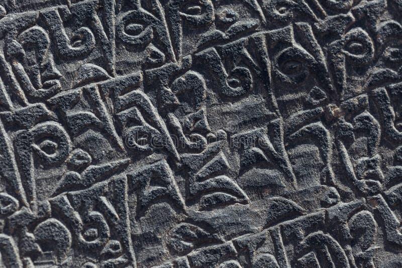 Antyczny tybetańczyka kamienia cyzelowanie obrazy stock
