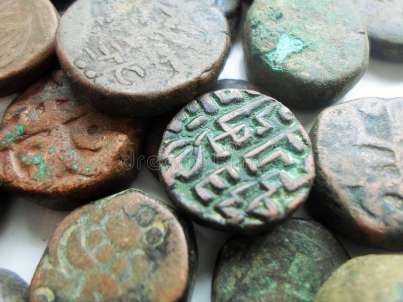 Antyka kamienia monety odizolowywać na bielu zdjęcia royalty free