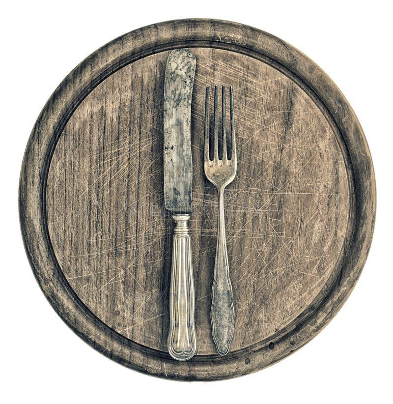 Antyka srebny cutlery i nieociosana drewniana deska kaczki formularzowi kuchenni ładni poparcia naczynia zdjęcie royalty free