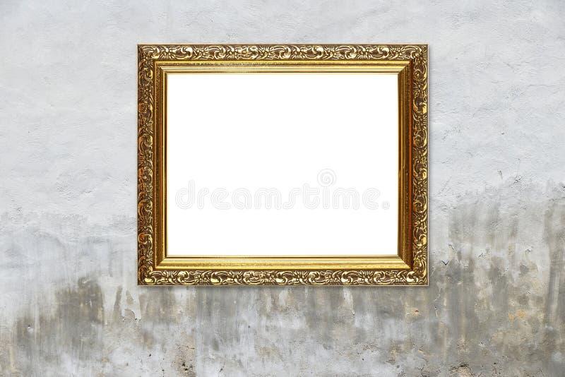Antykwarska złota obrazek fotografii rama na popielatej ścianie obrazy stock