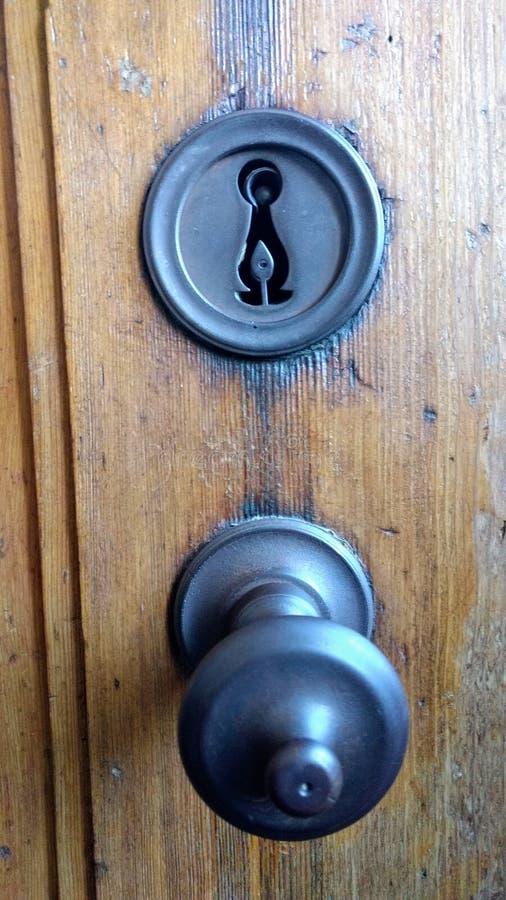 Antykwarski drzwi i kędziorek obraz royalty free