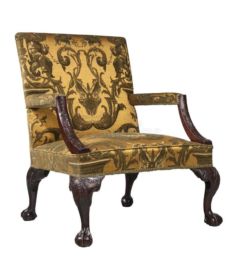 Antykwarski ręki krzesła koloru żółtego kierdla tapicerowanie odizolowywający na białym tle obraz royalty free