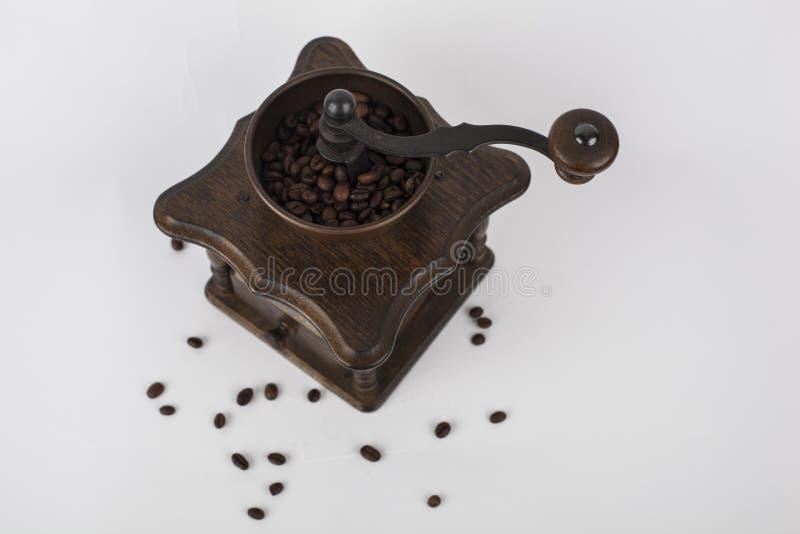 Antykwarski retro kawowy ostrzarz z kawowymi fasolami fotografia royalty free