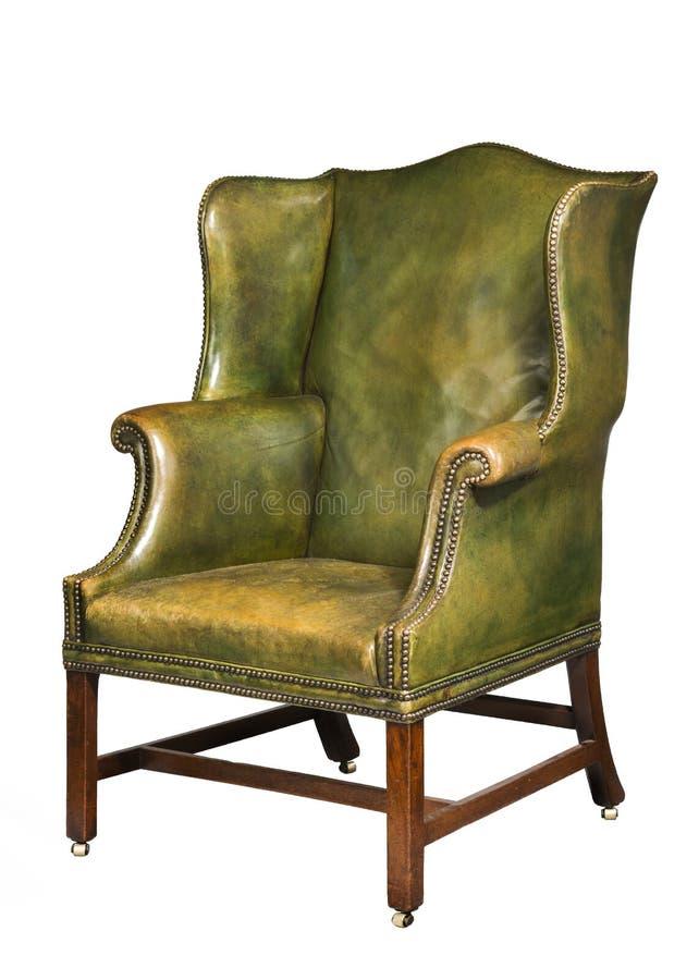 Antykwarski rzemienny skrzydłowy krzesło odizolowywający fotografia stock