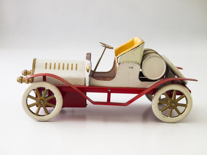 Antykwarskiego samochodu cyny zabawka, biel/ obrazy stock