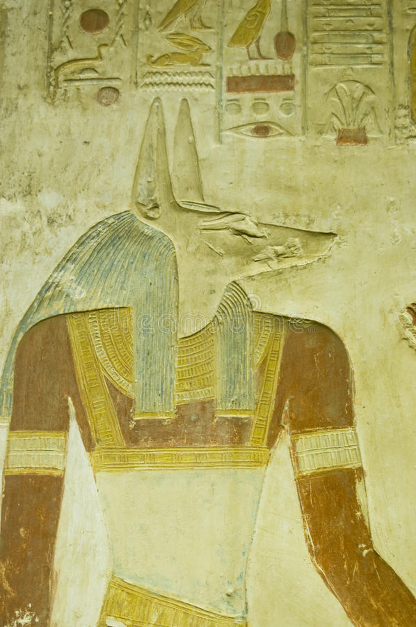 Anubis carving, Abydos Temple. Ancient Egyptian bas relief carving of the jackal headed god Anubis. The deity of death and mummification. Ancient sculpture on royalty free stock photos