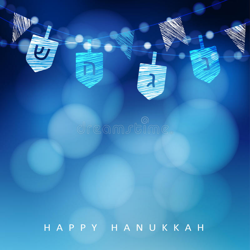 Anukkah blue background with string of light and dreidels. royalty free stock photo