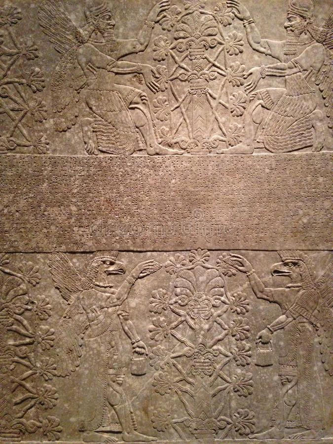 Anunnaki and Tree of Life - Relief Panel at Metropolitan Museum of Art in Manhattan, New York, NY. royalty free stock images