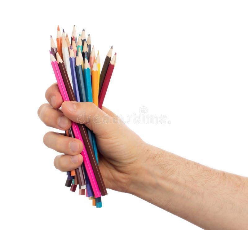 Använda blyertspennor i den isolerade handen royaltyfri bild