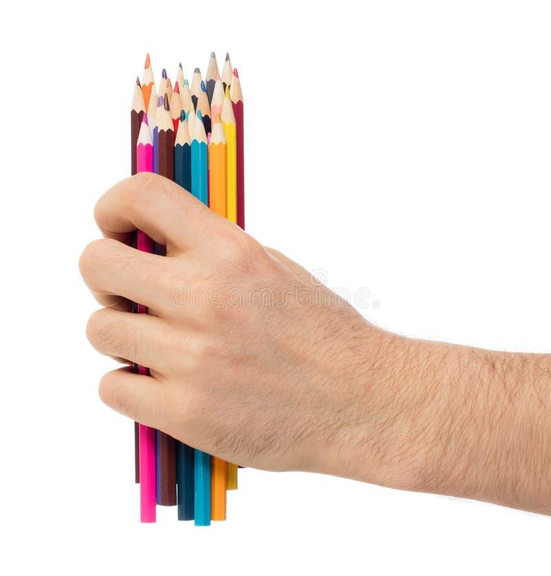 Använda blyertspennor i den isolerade handen arkivbilder