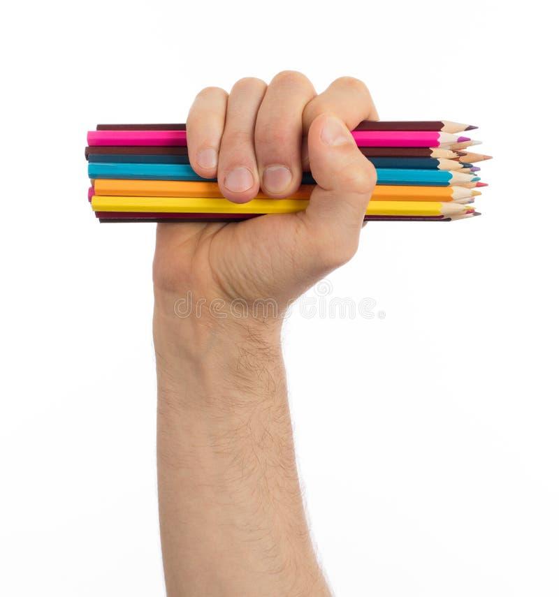 Använda blyertspennor i den isolerade handen royaltyfria bilder