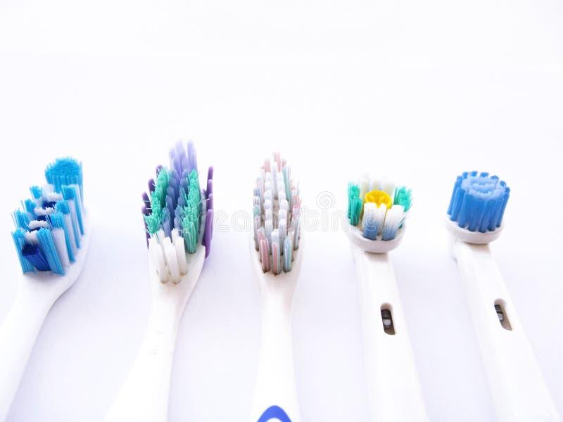 Använda tandborstar i vit royaltyfria foton