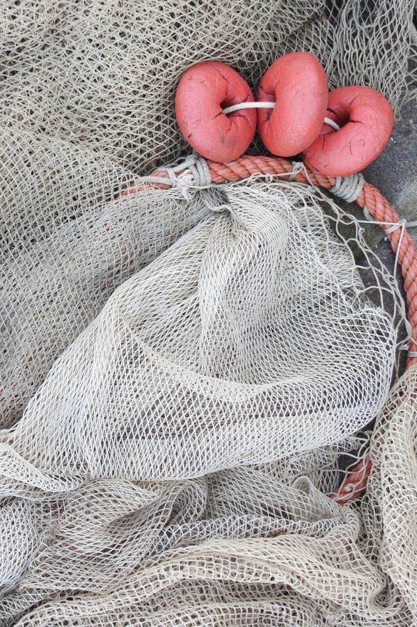 Använt fisknät med floaters royaltyfri bild
