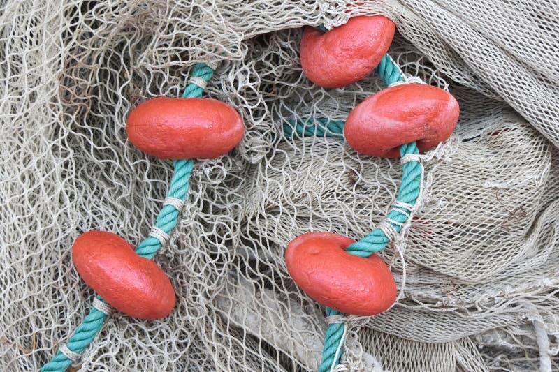 Använt fisknät med floaters royaltyfri fotografi